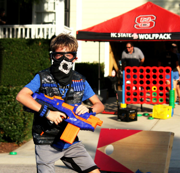 Kid in Nerf Gear With other games in background
